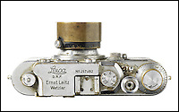 BNPS.co.uk (01202 558833)<br /> Pic: Bonhams/BNPS<br /> <br /> ***Use Full Byline***<br /> <br /> Yevgeny Khaldiei's Leica camera that is up for auction, which is estimated between &pound;230,000 - 340,000. The camera is up for auction on November 30th at Bonhams Leica Centenary Sale in Hong Kong.<br /> <br /> <br /> A camera which took one of the most iconic photographs of the Second World War has emerged for sale for 340,000 pounds.<br /> <br /> The Leica camera belonged to Soviet photographer Yevgeni Khaldei who was with the Red Army when they captured Berlin in May 1945, bringing about an end to WWII.<br /> <br /> Khaldei scaled the Reichstag on May 2 to capture on camera a soldier raising the Red Banner, the Soviet flag, to claim the symbolic building as under their control.<br /> <br /> In fact it was a restaging of a moment which had happened two days previously but resilient Nazi fighters had taken the original flag down overnight.<br /> <br /> The final image was heavily edited to add more smoke to the scene and also cover up the watches on the wrists of the soldiers which had been looted.<br /> <br /> It went on to become one of the most famous images of the war and was reproduced in publications around the world.<br /> <br /> It is often compared to the photograph of US troops raising the Stars and Stripes on the Japanese island of Iwo Jima.<br /> <br /> The camera is now tipped to fetch 340,000 pounds when it goes under the hammer at Bonhams.