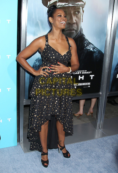 "Garcelle Beauvais.""Flight"" Los Angeles Premiere held at the Cinerama Dome, Hollywood, California, USA..October 23rd, 2012.full length black dress gold polka dot hand on hip arm mouth open smiling .CAP/ADM/RE.©Russ Elliot/AdMedia/Capital Pictures."