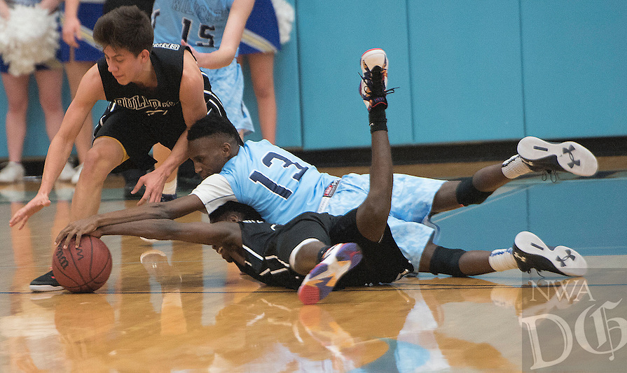 NWA Democrat-Gazette/J.T. WAMPLER  Springdale High School's David Carachure (left) and Devon Young (bottom) struggle for possession of the ball against Har-Ber guard Tevin Eckwood (13) Monday Feb. 8, 2016. For a gallery of images go to http://nwamedia.photoshelter.com/
