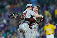 Oklahoma Sooners starting pitcher Dane Acker (28) hugs catcher Justin Mitchell (14) after the final out of their no-hitter against the LSU Tigers in game seven of the 2020 Shriners Hospitals for Children College Classic at Minute Maid Park on March 1, 2020 in Houston, Texas. The Sooners defeated the Tigers 1-0. (Brian Westerholt/Four Seam Images)