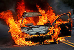 MANASQUAN, NJ — April 1, 2016 — A 2000 Ford Focus becomes fully engulfed in flames about 9:40am on Broad Street, here. The driver of the vehicle was not injured.  photo by Andrew Mills