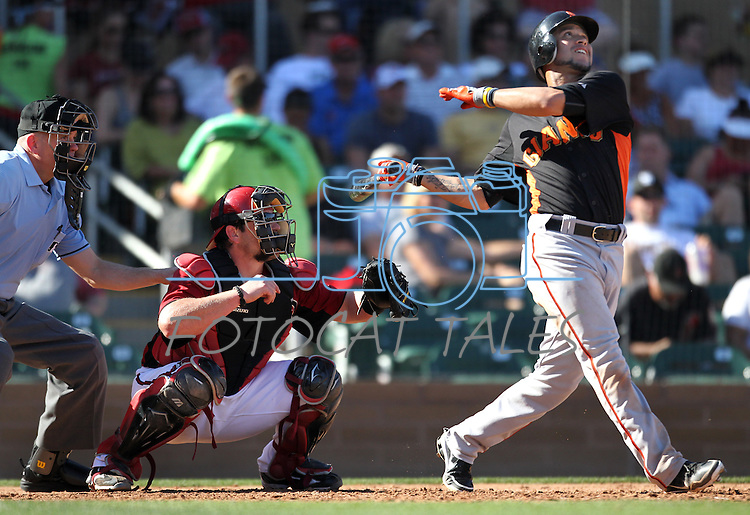 Konrad Schmidt catches for the Arizona Diamondbacks during Giants' Gregor Blanco's at bat during a Cactus League preseason game between the San Francisco Giants and the Arizona Diamondbacks in Scottsdale, Ariz., on Sunday, March 4, 2012. The Giants won 11-1..Photo by Cathleen Allison