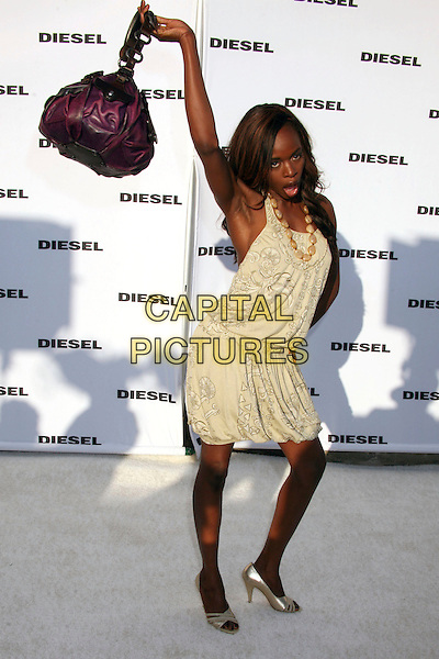 NZINGA BLAKE.Diesel Store Opening on Melrose Place, West Hollywood, California, USA..May 30th, 2007.full length hand arm in air purple funny black bag purse pattern necklace .CAP/ADM/BP.©Byron Purvis/AdMedia/Capital Pictures