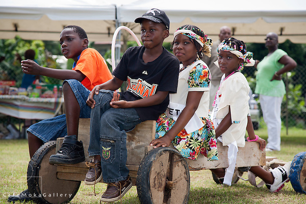 "Tobago Heritage Festival children playing on a homemade go-cart part of Mason Hall "" Games we used to play"", Tobago"