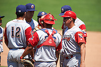 Williamsport Crosscutters manager Pat Borders (10) talks with Jan Hernandez (12), Lewis Alezones (15), Josh Tobias (hidden), Gregori Rivero (26) and Brendon Hayden (hidden) during a game against the Batavia Muckdogs on July 16, 2015 at Dwyer Stadium in Batavia, New York.  Batavia defeated Williamsport 4-2.  (Mike Janes/Four Seam Images)