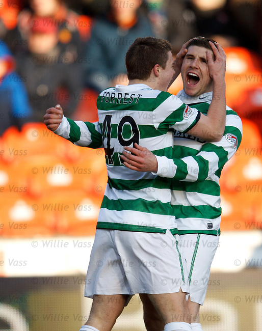Gary Hooper celebrates his goal with James Forrest