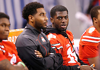Ohio State Buckeyes quarterback J.T. Barrett (16) talks to fellow injured teammate quarterback Braxton Miller (5) before the Big Ten Championship game at Lucas Oil Stadium in Indianapolis on Saturday, December 6, 2014. (Columbus Dispatch photo by Jonathan Quilter)