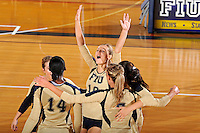 11 September 2011:  FIU's Marija Prsa (10) and teammates celebrate winning a key point in the first set as the FIU Golden Panthers defeated the Florida A&M University Rattlers, 3-0 (25-10, 25-23, 26-24), at U.S Century Bank Arena in Miami, Florida.