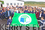 FLY THE FLAG: Cllr John Brassil and Fr Tom Leane help to raise the green flag at Glenderry school in Ballyheigue last Thursday.