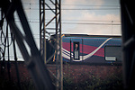 """© Joel Goodman - 07973 332324 . 04/07/2015 . Manchester , UK . A man looks out of a train window at the crowd . Fans at the Castlefield Bowl as part of the """" Summer in the City """" festival in Manchester. Photo credit : Joel Goodman"""