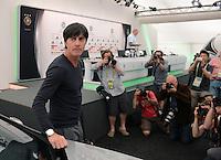 FUSSBALL INTERNATIONAL  EURO 2012   11.06.2012  Pressekonferenz der deutschen Nationalmannschaft in Danzig Trainer Joachim Loew (li, Deutschland) mit Fotografen