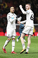 Martin Olsson and Oliver McBurnie of Swansea City celebrate their team's win during the Premier League match between Watford and Swansea City at the Vicarage Road, Watford, England, UK. Saturday 30 December 2017