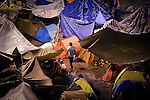 A man walk in camp of the Puerta del Sol square in Madrid on June 4, 2011 to denounce political corruption, welfare cuts and unemployment. Young people are camping in main squares across Spain in the largest spontaneous protests since the country plunged into recession after the collapse of a property bubble in 2008. (c) PEDRO ARMESTRE