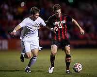 Patrick Mullins (15) of Maryland shields the ball away from Brandon Kolczynski (3) of Pittsburgh during the game at Ludwig Field on the campus of the University of Maryland in College Park, MD.  Maryland defeated Pittsburgh, 2-0.