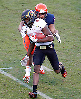 Maryland Terrapins wide receiver Kevin Dorsey (12) runs past Virginia Cavaliers guard Ryan Doull (63) during the game in Charlottesville, Va. Maryland defeated Virginia 27-20.