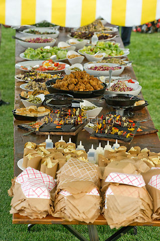 Table of food served buffet-style as United States President Donald J. Trump and first lady Melania Trump host the annual Congressional Picnic on the South Lawn of the White House in Washington, DC on Thursday, June 22, 2017.<br /> Credit: Ron Sachs / CNP /MediaPunch