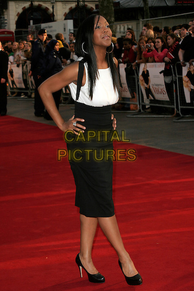 "ANJELLICA BELL.World premiere of ""What Happens In Vegas"" held at the Odeon Leicester Square, London, England. .April 22nd 2008 .full length black white sleeveless angelica anjelica dress hands on hips .CAP/AH.©Adam Houghton/Capital Pictures."