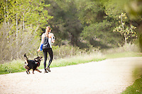 Girl Going for a Walk with her Dog on Trail