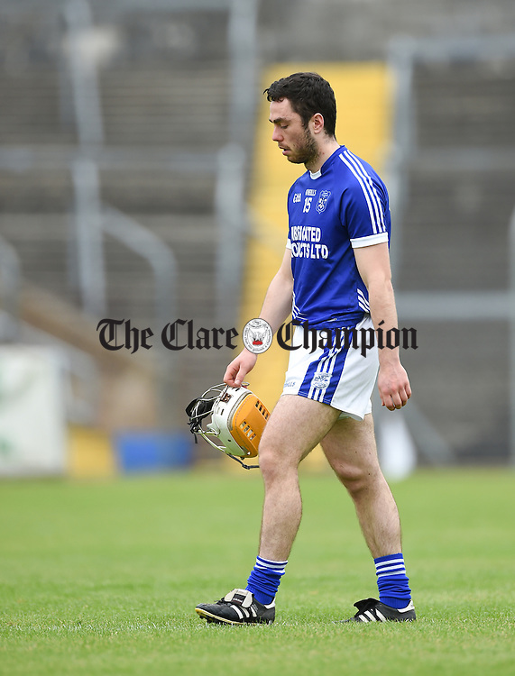 Conor Mc Grath of Cratloe heads to the dressing room at half time after being red carded early in the game by referee Rory Hickey following an incident during their game against Sixmilebridge in Cusack Park. Photograph by John Kelly.