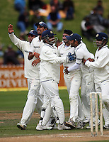 Indian players congratulate Harbhajan Singh on dismissing Jesse Ryder for a duck during day four of the 3rd test between the New Zealand Black Caps and India at Allied Prime Basin Reserve, Wellington, New Zealand on Monday, 6 April 2009. Photo: Dave Lintott / lintottphoto.co.nz.