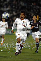 LA Galaxy forward Carlos Ruiz (20) chases a ball played into space during an MLS regular season match against the Colorado Rapids at Dicks Sporting Goods Park in Commerce City, Colorado on March 29, 2008. Also chasing is Rapids defender Kosuke Kimura (27). The Rapids defeated the Galaxy 4-0.