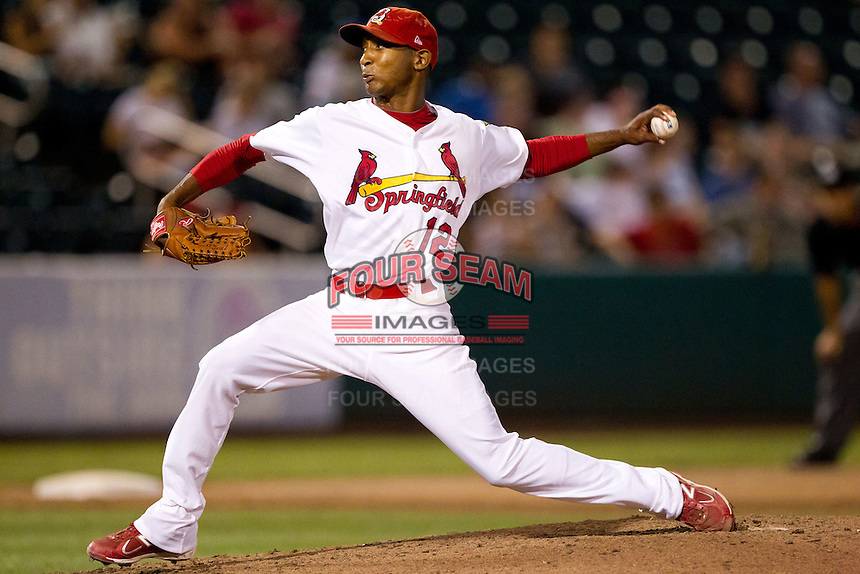 Samuel Freeman (12) of the Springfield Cardinals delivers a pitch during a game against the Northwest Arkansas Naturals at Hammons Field on August 1, 2011 in Springfield, Missouri. Springfield defeated Northwest Arkansas 7-1. (David Welker / Four Seam Images)