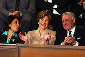 Ms. Rend Al-Rahim, Iraqi Senior Diplomatic Representative, left, first lady Laura Bush, center, and  Dr. Adnan Pachachi; and Doctor Adnan Pachachi, President, Iraqi Governing Council, and President of the Iraqi Independent Grouping, right, applaud a passage in United States President George W. Bush's State of the Union Address to a Joint Session of the United States Congress on January 20, 2004.<br /> Credit: Ron Sachs / CNP
