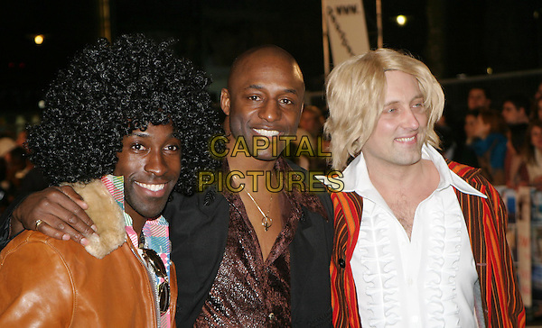 JOHN FASHANU.Starsky & Hutch UK premiere in Odeon Leicester Square.11 March 2004.fancy dress costume.www.capitalpictures.com.sales@capitalpictures.com.© Capital Pictures.