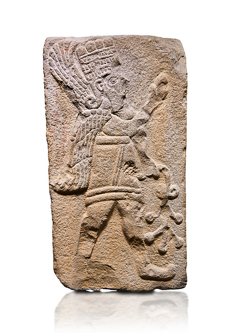 Aslantepe Hittite relief sculpted orthostat stone panel. Limestone, Aslantepe Malatya, 1200-700 B.C. Anatolian Civilisations Museum, Ankara, Turkey. Winged protective god holds a branch with fruits. in his left hand, and a fruit in his right hand.<br /> <br /> Against a white background.