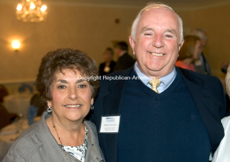 TORRINGTON CT. 28 April 2014-042817SV17-From left, Denise Sorvillo of Torrington and Michael McGuffie, owner of American Bark Mulch &amp; Playground Surfacing, attend The Northwest Connecticut Chamber of Commerce Annual Meeting &amp; Chamber Hall of Fame Induction at the Cornucopia Banqueting Hall in Torrington Monday. McGuffie was inducted into the Chamber Hall of Fame.<br /> Steven Valenti Republican-American