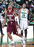 Texas State Bobcats forward Tony Bishop (22) and North Texas Mean Green forward Kedrick Hogans (24) waiting for the ball after a free throw in the game between the Texas State Bobcats and the University of North Texas Mean Green at the North Texas Coliseum,the Super Pit, in Denton, Texas. UNT defeated Texas State 85 to 62