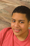 15 year old teenage boy at home portrait closeup vertical