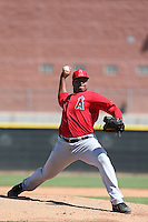Eduard Santos #43 of the Los Angeles Angels pitches during a Minor League Spring Training Game against the Oakland Athletics at the Los Angeles Angels Spring Training Complex on March 17, 2014 in Tempe, Arizona. (Larry Goren/Four Seam Images)