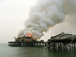 The West Pier in Brighton burns. The already derelict pier caught fire on March 28 2003.