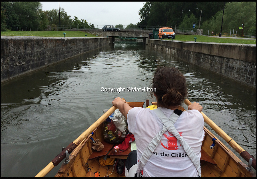 BNPS.co.uk (01202 558833)<br /> Pic: MatHilton/BNPS<br /> <br /> Rowing in the rain near Amiens.<br /> <br /> An adventurous husband and wife have completed a grueling 870 mile journey to the Mediterranean in a homemade wooden boat. <br /> <br /> Mat and Polly Hilton traveled from England all the way to the South of France in a tiny 13ft sailboat to raise money for charity. <br /> <br /> The epic voyage took the intrepid duo 56 days to complete and exhaustingly they were forced to row almost the entire way due to poor sailing conditions.