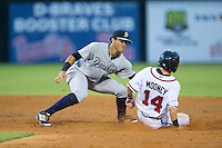 Marcus Mooney (14) of the Danville Braves is tagged out by Pulaski Yankees shortstop Wilkerman Garcia (28) as he tries to steal second base at American Legion Post 325 Field on August 1, 2016 in Danville, Virginia.  The Yankees defeated the Braves 4-1.  (Brian Westerholt/Four Seam Images)