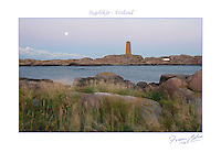 The full moon lingers at dawn over Segelskär daybeacon on the outer archipelago skerry near Tammisaari, Finland.