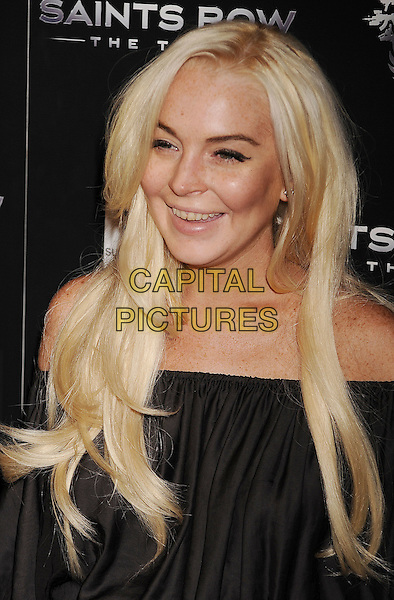 Lindsay Lohan.Saints Row: The Third concert and event Held at Superclub, Hollywood, California, USA..October 12th, 2011.headshot portrait black off the shoulder smiling teeth circle of shame look closer .CAP/ROT/TM.©Tony Michaels/Roth Stock/Capital Pictures