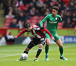 Kieron Freeman of Sheffield Utd tackles Callum Robinson of Preston North End during the championship match at the Bramall Lane Stadium, Sheffield. Picture date 28th April 2018. Picture credit should read: Simon Bellis/Sportimage
