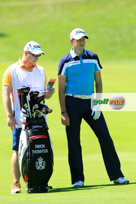 Gary (Caddy) and Simon Thornton (IRL) on the 18th during Thursday's Round 1 of The Open De Espana at The PGA Catalunya Resort. 15th May 2014.<br /> Picture:  Thos Caffrey / www.golffile.ie
