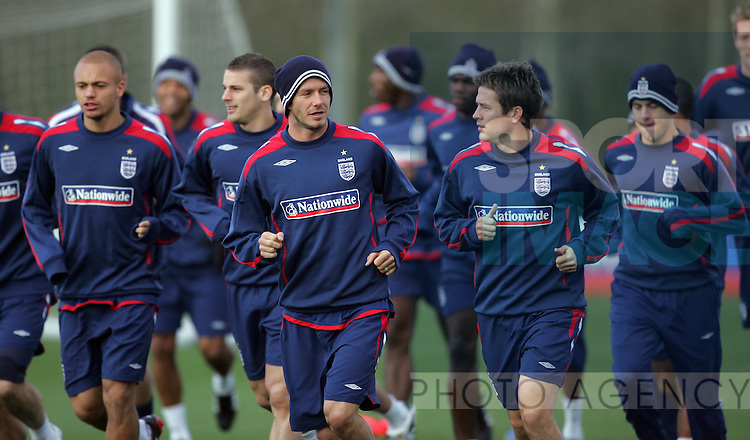 England's David Beckham chats with Michael Owen
