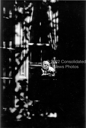 United States President Gerald R. Ford works in the Oval Office at the White House in Washington, D.C. on May 14, 1975.  The photos was taken through a window from the colonnade.<br /> Mandatory Credit: David Hume Kennerly / White House via CNP