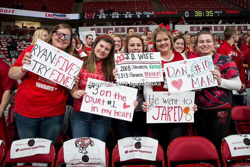 Wisconsin Badger fans hold up signs honoring the senior basketball players during a Big Ten Conference NCAA college basketball game against the Purdue Boilermakers Sunday, March 3, 2013, in Madison, Wis. Purdue won 69-56. (Photo by David Stluka)