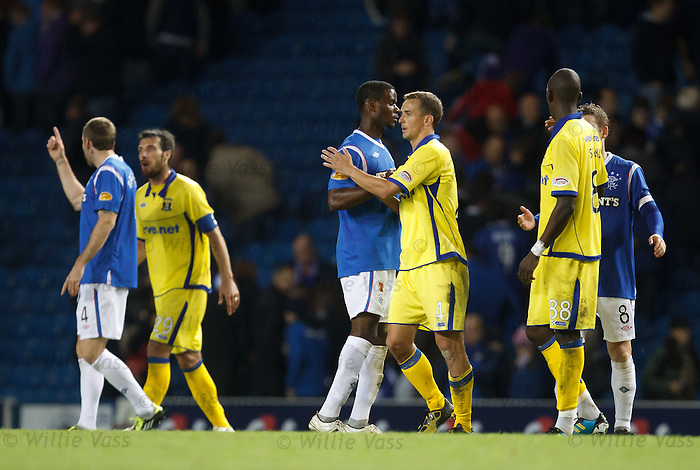 Maurice Edu and James Fowler shake hands as Kirk Broadfoot and Manuel Pascali square up and point to the tunnel in the background