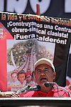 Electric union leader Martin Esparza (R) gives a speech to the crowd during the May Day rally at the Mexico City's main square Zocalo, May 01, 2010. Thousands of workers marched on a Mexico City main thoroughfare demanding to fight against the labour policy by the Calderon's government. Photo by Heriberto Rodriguez