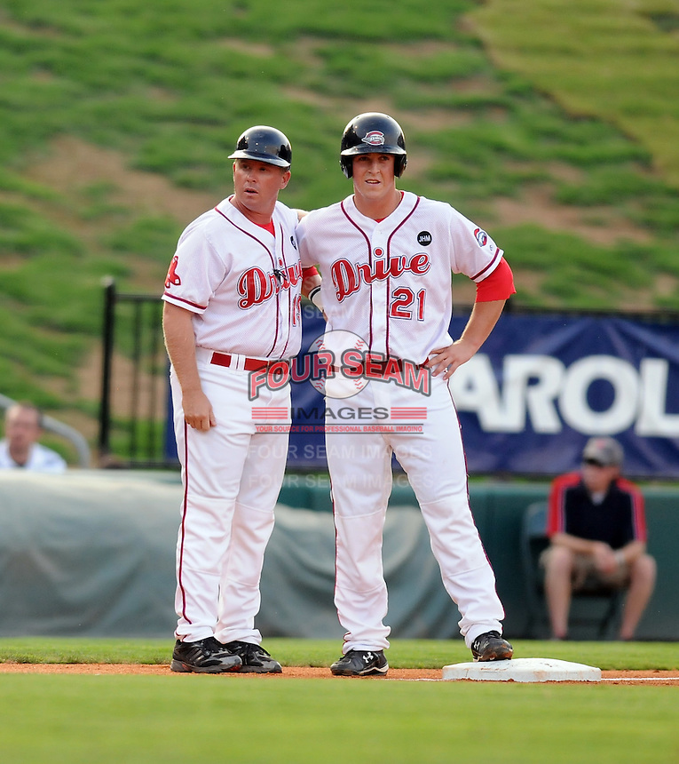 August 25, 2009: Infielder Chris McGuiness (21) (right) of the Greenville Drive, 2009 13th round draft pick of the Boston Red Sox out of The Citadel, stands at third base with manager Kevin Boles in a game at Fluor Field at the West End in Greenville, S.C. Photo by: Tom Priddy/Four Seam Images