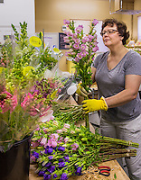 Suzanne Frye with fresh cut local cool season annual flowers at The Gardeners Workshop