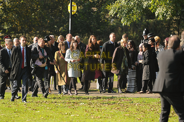 Catherine, Duchess of Cambridge.visiting Elswick Park. Newcastle, England..10th October 2012.Kate Middleton royal royalty full length brown coat jacket maroon burgundy.CAP/CAS.©Bob Cass/Capital Pictures