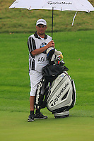 Felipe Aguilar's (CHI) caddy Omar at the 1st green during Thursday's Round 1 of the 2014 BMW Masters held at Lake Malaren, Shanghai, China 30th October 2014.<br /> Picture: Eoin Clarke www.golffile.ie