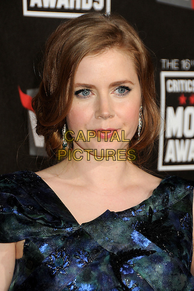 AMY ADAMS .16th Annual Critics' Choice Movie Awards held at the Hollywood Palladium, Hollywood, California, USA, 14th January 2011..portrait headshot hair up  blue green floral print .CAP/ADM/BP.©Byron Purvis/AdMedia/Capital Pictures.